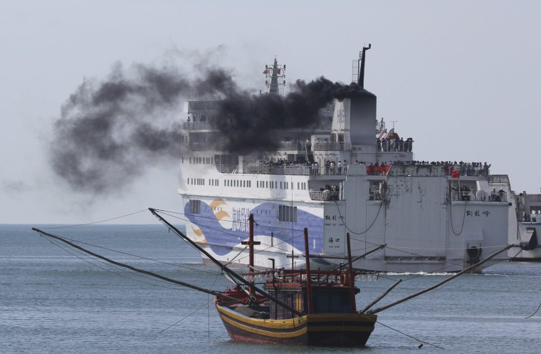 Image: A ship carrying Chinese workers leaves Vung Ang por