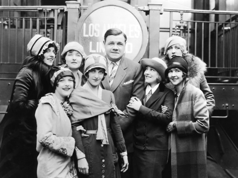 Babe Ruth and some of his fans. His gold pocket watch sold for $650,000 at auction -- less than was expected.