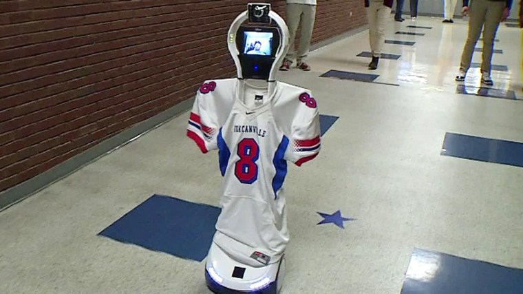 Image: An injured student attends school with the help of a robot.