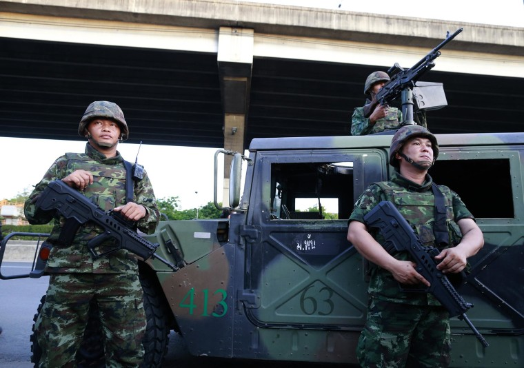 Image: Thai soldiers take up position on a street outside the Centre for the Administration of Peace and Order (CAPO) after soldiers were sent in to seize the building