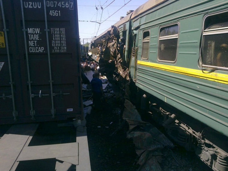 Image: A view shows a passenger train damaged in a collision with a freight train in Moscow region