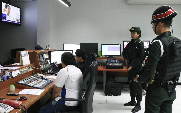 Image: Soldiers inside the control room of the offices of the National Broadcasting Services of Thailand