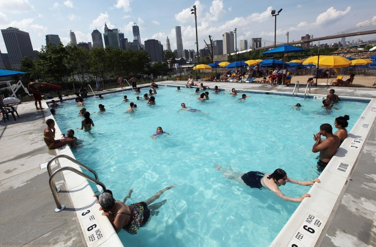 Image: Kids play in a pool in New York City