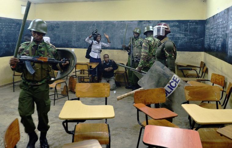 Image: Kenyan riot police clash with students inside a classroom in Nairobi University