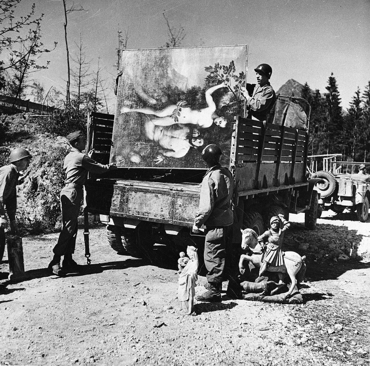 Image: Unidentified military personnel unload some of the art treasures recovered from Herman Goering's cave