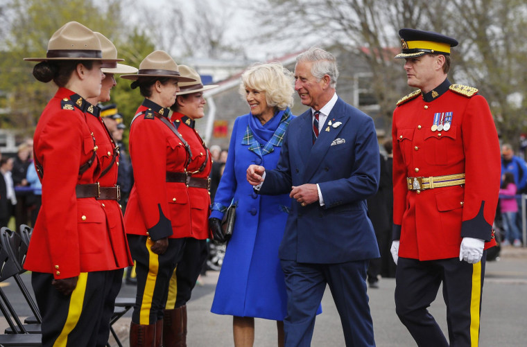 Image: Britain's Prince Charles and his wife Camilla, Duchess of Cornwall are greeted by Royal Canadian Mounted Police in Pictou, Nova Scotia