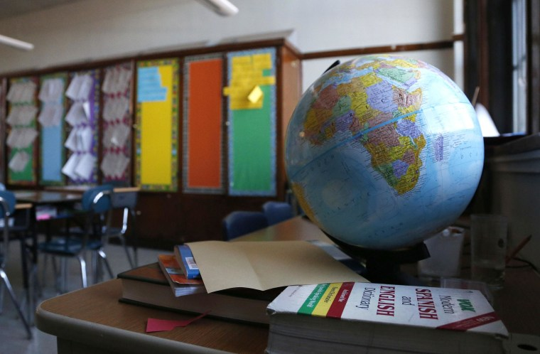 Image: A globe sits in an elementary school classroom.