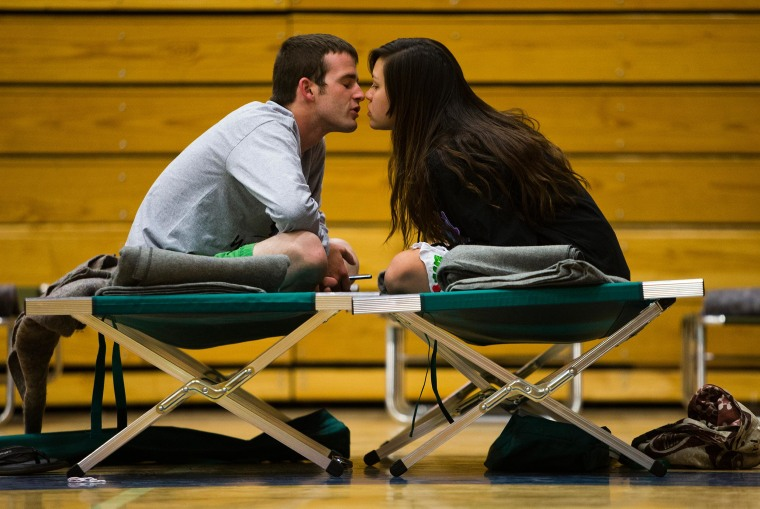 Nathan Westerfield, 22, kisses his new bride, Mickella, 20, at the Red Cross shelter set up at Sinagua Middle School in Flagstaff, Ariz.