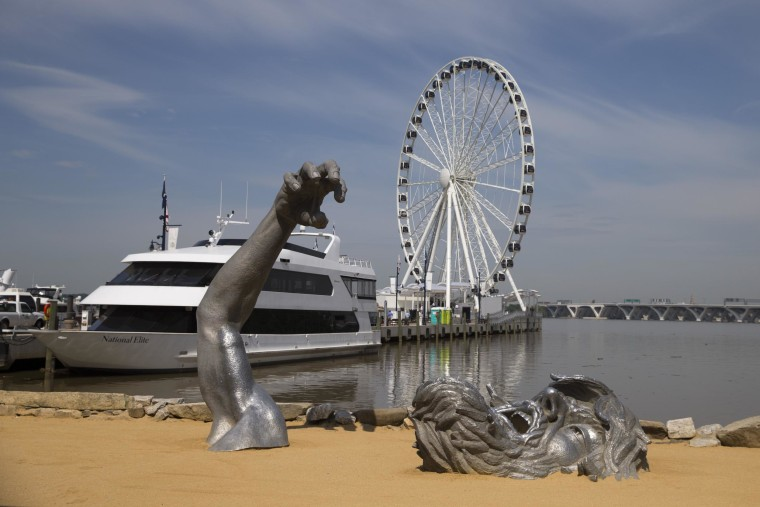 Image: The Awakening sculpture and Capital Wheel