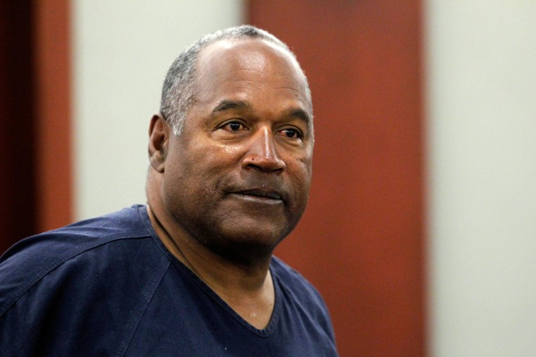 Image: O. J. Simpson stands during a break during the second day of evidentiary hearing in Clark County District Court