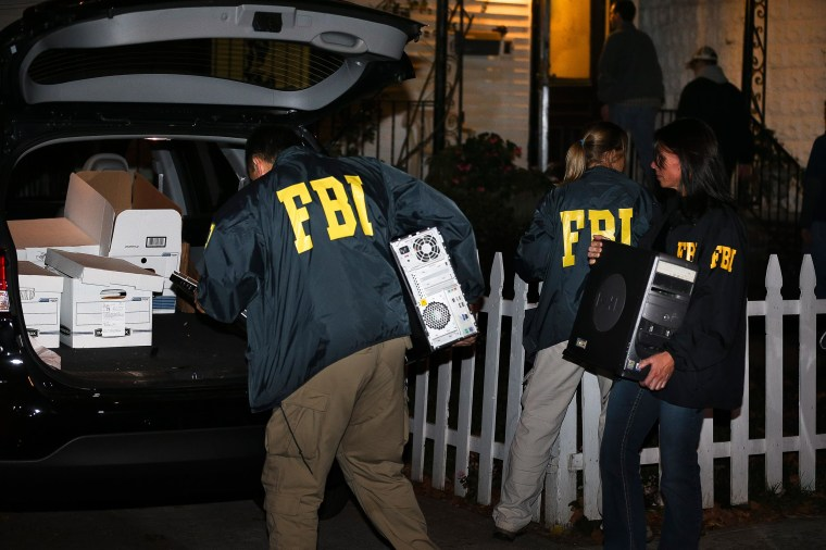 Image: FBI agents remove evidence from the Brooklyn residence of Rabbi Mendel Epstein during an investigation