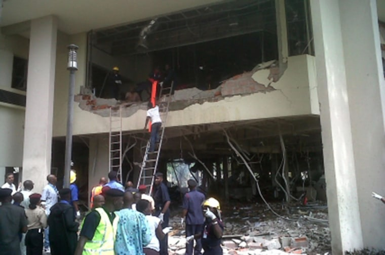 Image: Firefighters and rescue workers respond after a large explosion struck the United Nations' main office in Nigeria's capital Abuja in 2011