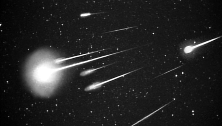 Shooting stars light up the sky during the Leonid meteor storm of 1999, as seen from NASA's Leonid Multi-Instrument Aircraft Campaign.