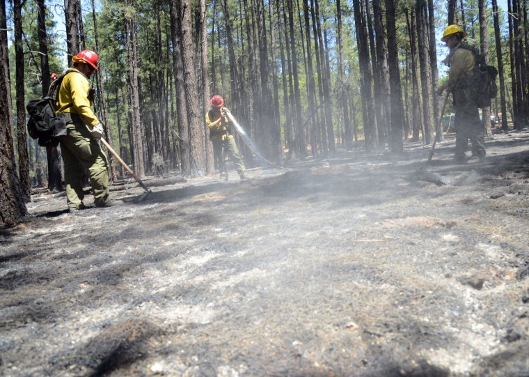 Image: Crews work hotspots near Sedona, Arizona, on Thursday