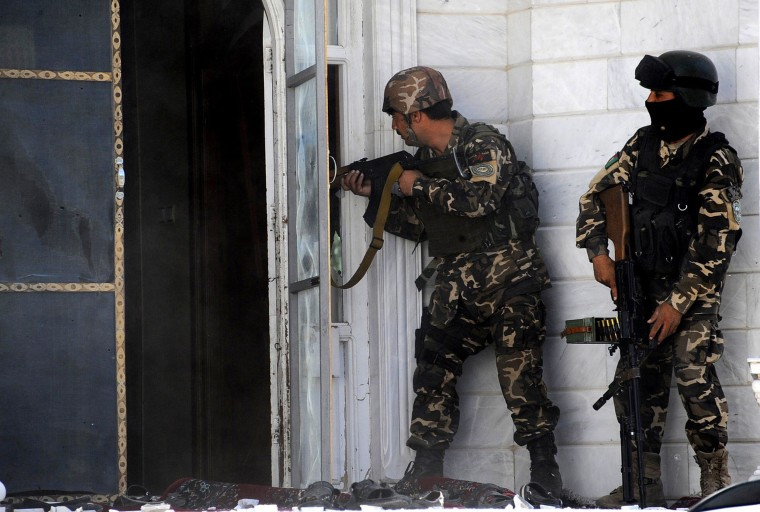 Image: Afghan military personnel take position at the scene of an attack on the Indian consulate in Herat