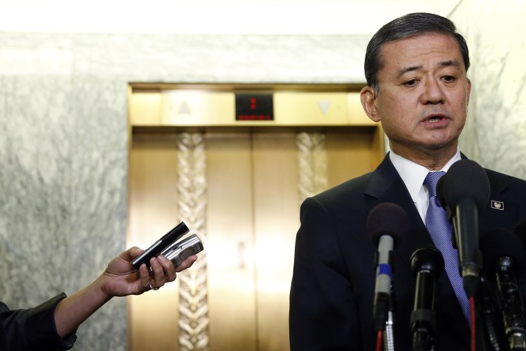 Image: Shinseki addresses reporters after testifying before a Senate Veterans Affairs Committee hearing on VA health care, on Capitol Hill in Washington