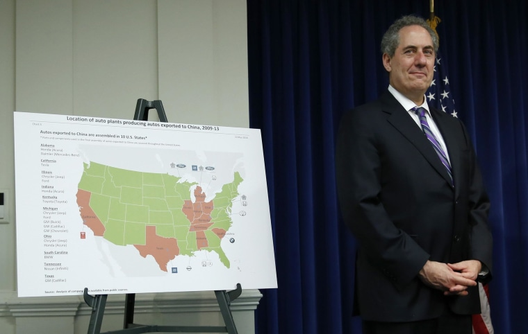U.S. Trade Representative Michael Froman stands beside a map showing U.S. auto plants that export to China. The WTO ruled in favor of Washington in a trade dispute over Chinese duties on imports.