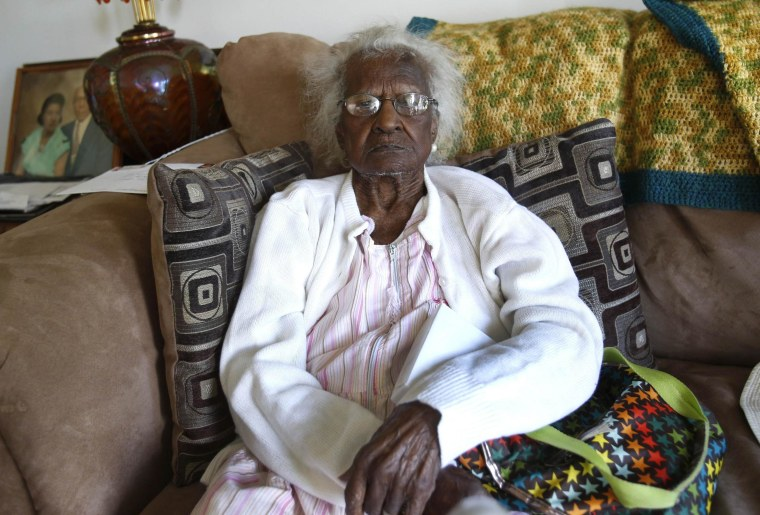 Image: Talley sits on her couch for a photograph during her 115th birthday in her home in Inkster