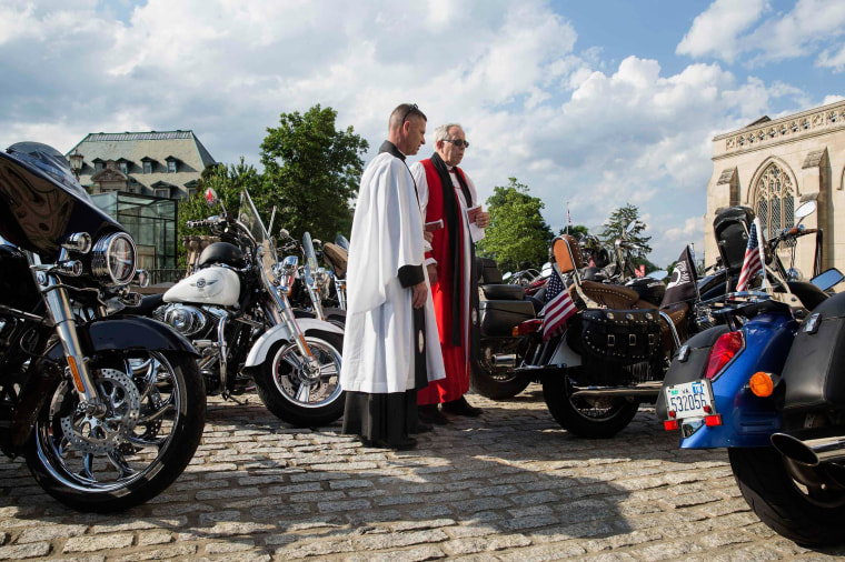 Image: Members of the Episcopal Church before the 'Blessing of the Bikes' ceremony at the National Cathedral in Washington