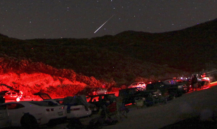 A Camelopardalid meteor flashes north of Castaic Lake in California on Friday night. Cars lined up to catch sight of what some hoped might be a meteor storm, but the show didn't live up to expectations.