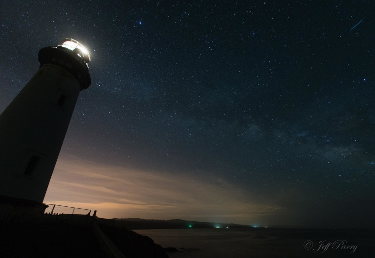 Image: A meteor shoots across the sky as seen from Pigeon Point Lighthouse in California.