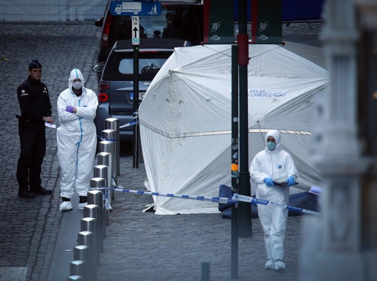 Image: Police officers and crime scene investigators work at the scene of a shooting near the Jewish Museum in Brussels