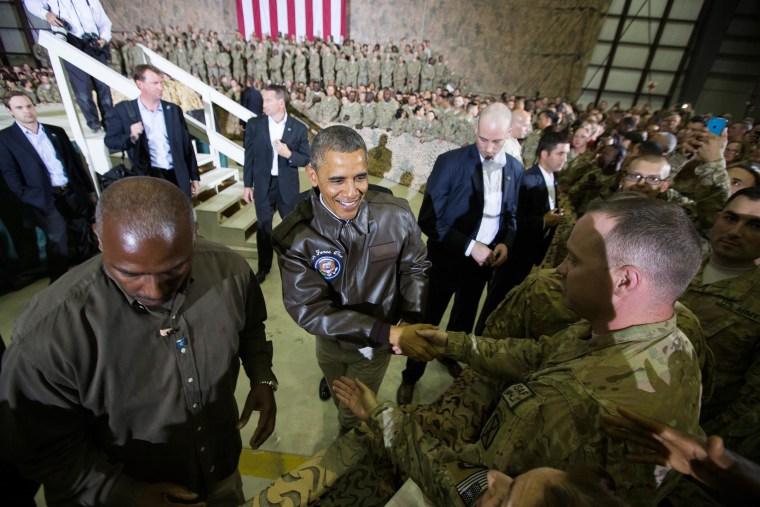 Image: President Barack Obama shakes hands at a troop rally at Bagram Air Field