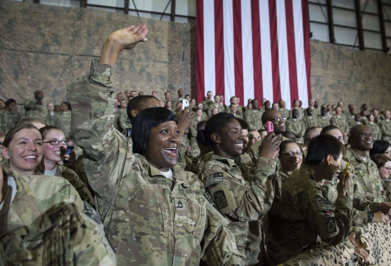 Image: US troops cheer President Barack Obama during his surprise visit to Bagram Air Field