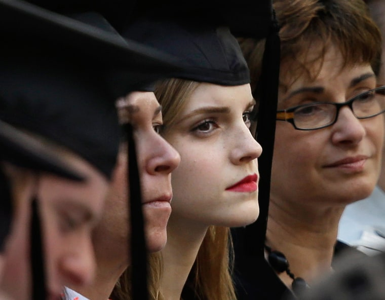 Image: Actress Emma Watson, center right, attends commencement at Brown University