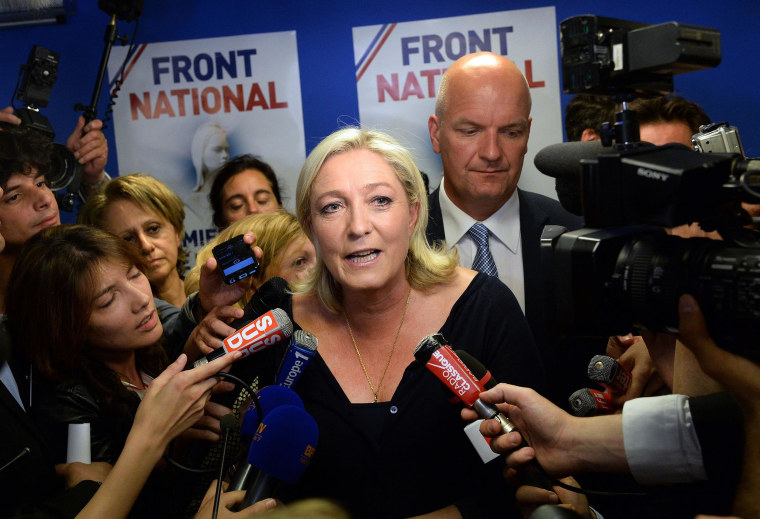 Image: French far-right Front National (FN) party president Marine Le Pen reacts at the party's headquarters