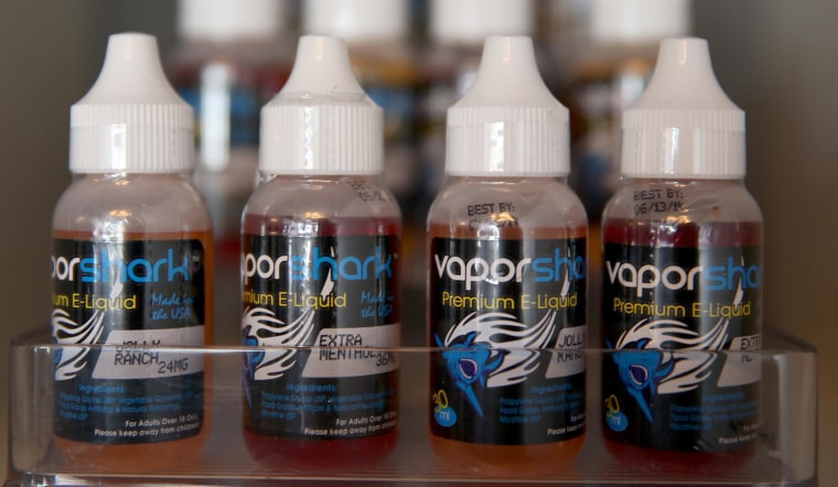 Image: Bottles of different flavors of electronic cigarette liquid.