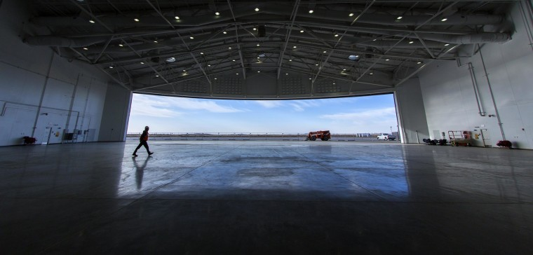 "Image: Virgin Galactic leases Spaceport America's  ""Gateway to Space""  building which houses a massive hangar which can house two WhiteKnight2 aircraft and between three to five SpaceShip2 vehicles"