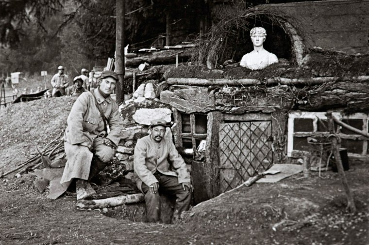 "Image: French soldiers posing outside their shack, called ""The Chalet,"" at la Sapiniere near Lachalade on the Argonne front, eastern France in World War I"