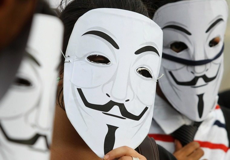 Image: Activists supporting the group Anonymous wear masks