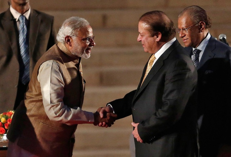 Image: India's PM Narendra Modi is greeted by his Pakistani counterpart Nawaz Sharif