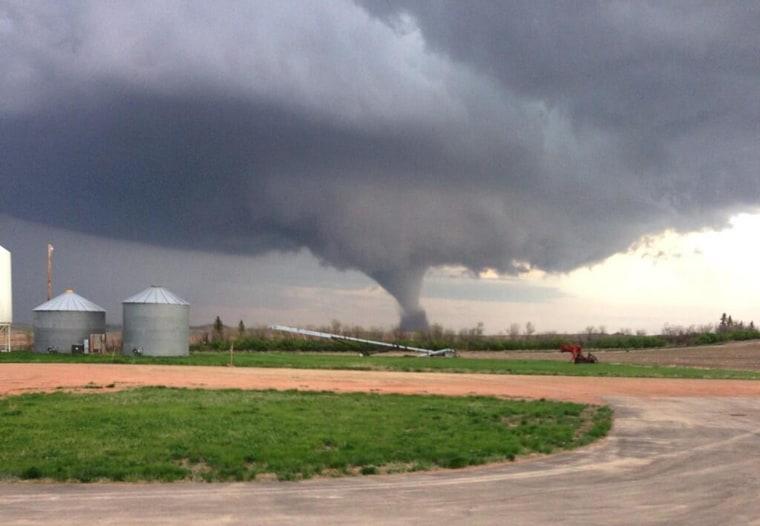 Image: A tornado barrels through Watford City, N.D., on Monday, May 26.