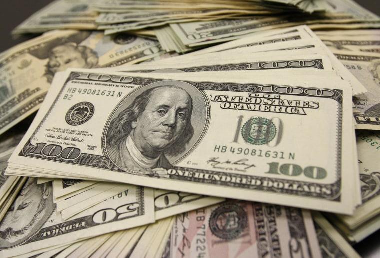 Image: U.S. dollar bills at an office of Interbank Inc. money exchange in Tokyo on Nov. 27, 2009