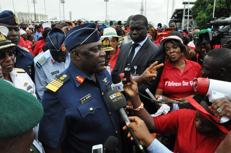 Image: Nigeria's chief of defense staff Air Marshal Alex S. Badeh, center, speaks during a demonstration