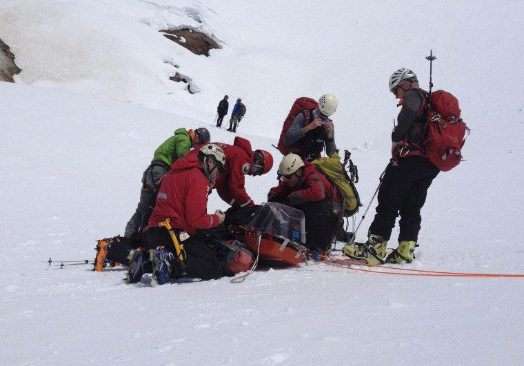 Image: Members of the Portland Mountain Rescue team tend to rescued hiker James Michael Adams after rescue on Mt. Hood, Oregon