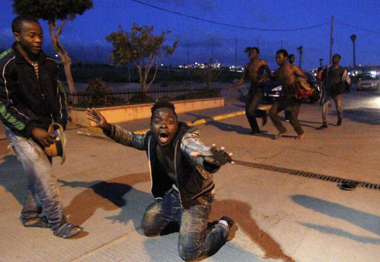 Image: Migrants try to storm Spanish enclave in North Africa