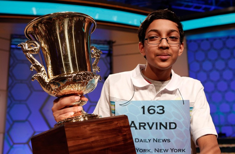 Image: Arvind Mahankali of New York holds his trophy after winning the National Spelling Bee at National Harbor in Maryland