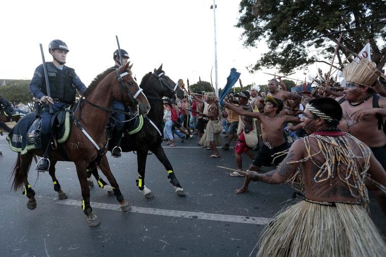 Image: Police confront native Brazilians during a demonstration in Brasilia
