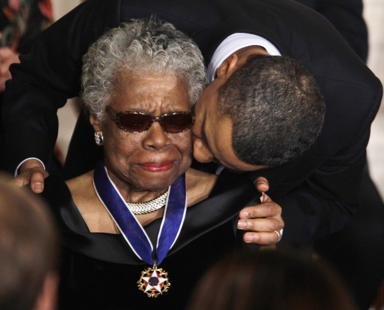 Image: President Barack Obama kisses author and poet Maya Angelou after awarding her the 2010 Medal of Freedom