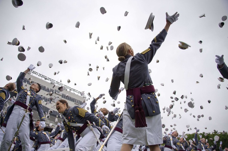 Image: The 2014 graduating class at the United States Military Academy at West Point, N.Y. throw their covers in the air at the end of the ceremony