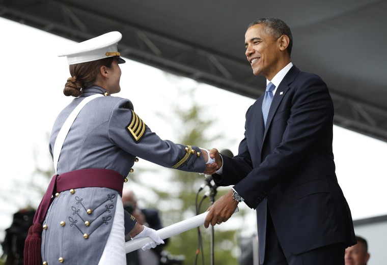 Image: U.S. President Obama hands a diploma to a graduate during a commencement ceremony at the United States Military Academy at West Point