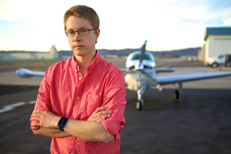 Image: Matt Guthmiller, a 19-year-old freshman at MIT, poses with a single engine plane