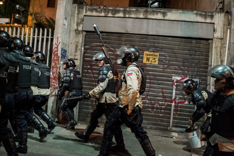 Image: PMembers of the National Bolivarian police clash with opposition demonstrators in Caracas, Venezuela