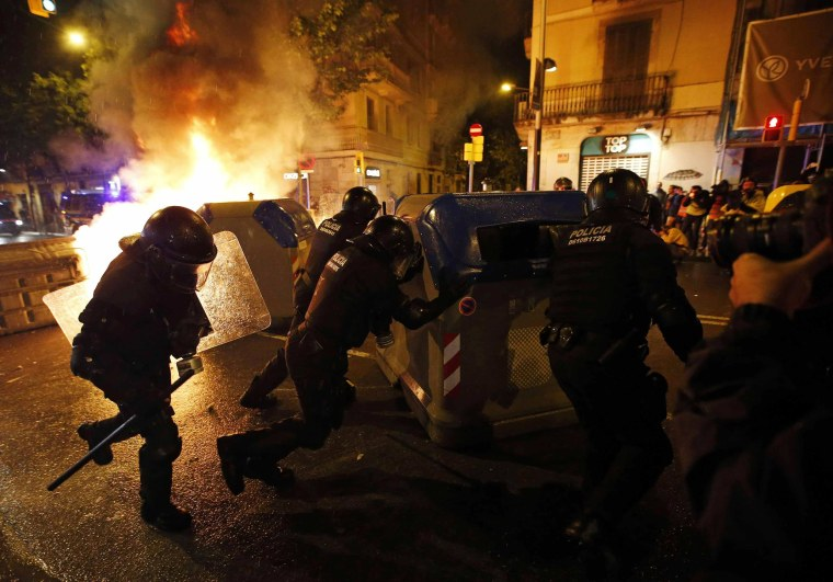 Image: Police remove containers during a protest against the eviction of squatters from Can Vies building at Sants neighborhood in Barcelona