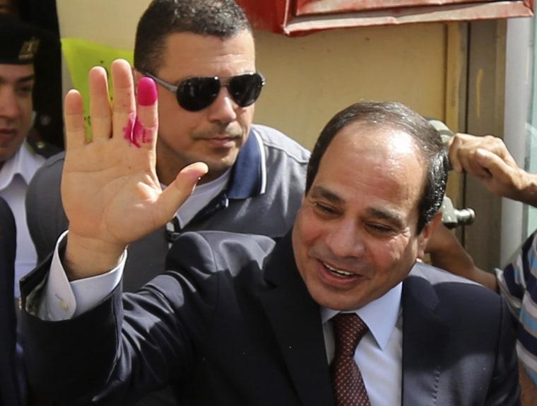 Image: Abdel Fattah el-Sissi gestures after casting ballot in Cairo