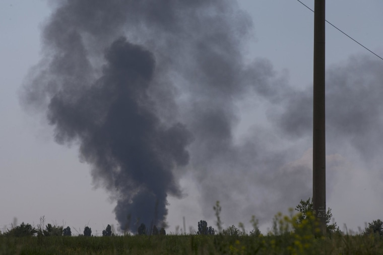 Image: Black smoke rises from a shot down Ukrainian Army helicopter outside Slovyansk
